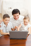 Family with laptop Stock Photography