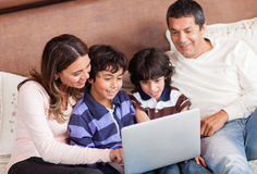 Family with a laptop Royalty Free Stock Image
