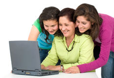Family on a laptop Royalty Free Stock Images