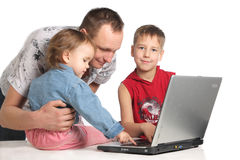 Family with laptop Stock Image