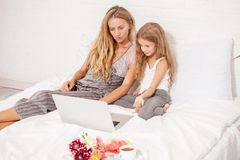 Mother and child with computer at home Royalty Free Stock Photo