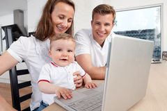 Family with Laptop Computer Stock Photos