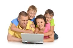 Family with laptop Stock Photo
