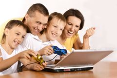 Family with laptop Royalty Free Stock Photo