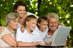Family with laptop in nature Royalty Free Stock Image