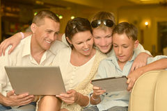 Family with laptop and tablet pc stock images