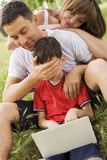Family with laptop XX Stock Image