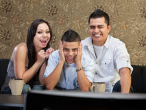 Family Laughing at TV Royalty Free Stock Images