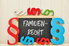 Family Law Advocate text on blackboard. German word Familienrecht family law as text on blackboard with many colorful paragraphs Royalty Free Stock Images