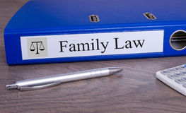 Family Law - blue binder in the office Stock Image