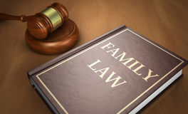Family Law Book. Family law concept with sign printed on a book and a gavel on a wooden desk 3D illustration Stock Photography