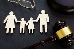 Family law concept. Figures and gavel. Divorce. stock photos