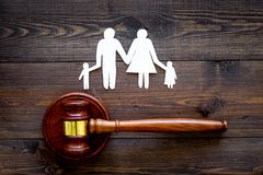 Family law, family right concept. Child-custody concept. Family with children cutout near court gavel on dark wooden royalty free stock image