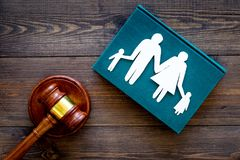 Family law, family right concept. Child-custody concept. Family with children cutout near court gavel on dark wooden. Background top view stock image