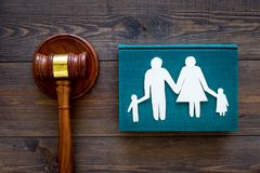 Family law, family right concept. Child-custody concept. Family with children cutout near court gavel on dark wooden. Background top view royalty free stock images