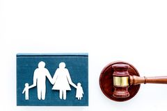 Family law, family right concept. Child-custody concept. Family with children cutout near court gavel on white. Background top view stock photo