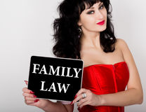 Family law written on virtual screen. technology, internet and networking concept. sexy woman in a red corset holding pc. Tablet Stock Image
