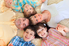 Family laying in a circle royalty free stock photography
