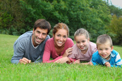 Family laying in garden royalty free stock images