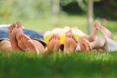 Family Laying in Park Stock Photography