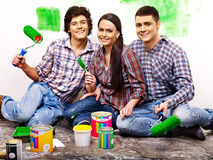 Family laying parquet at home. Royalty Free Stock Photography