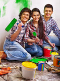 Family laying parquet at home. Stock Photo