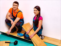 Family laying parquet at home Royalty Free Stock Images