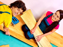 Family laying parquet at home Stock Image