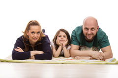 Family laying in a row Royalty Free Stock Photos