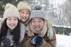 Family laying in snow for portrait Stock Image