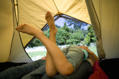 Family laying in tent Royalty Free Stock Photos