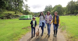 Family Hiking in the Lake District. Family are leaving the campsite they`re staying in to go for a hike in the Lake District stock footage