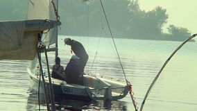 Family leaving dock in small sailing yacht, vacation, holiday. Stock footage stock video footage
