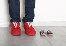Family legs feet standing together, woman legs and small baby shoes on light background, conceptual photo of family and maternity, Royalty Free Stock Photo
