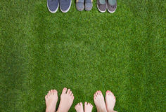 Family legs  standing  opposite shoes Stock Photography