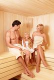 Family leisure. Happy family with a child in a sauna Stock Image