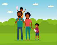 Family leisure. African family in the amusement Park. Family walks in the Park, children eating cotton candy. Royalty Free Stock Photos