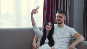 Family leisure communication couple cuddle selfie. Family home leisure. selfie time. communication couple relationship. husband and wife hugging stock video footage