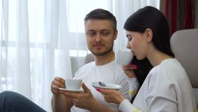 Family leisure communication couple drinking tea. Family casual home leisure. communication couple relationship. man and woman drinking tea or coffee stock video footage