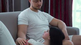 Family leisure communication relaxed couple home. Family casual leisure. couple love cuddle affection. relaxed couple communication at home. husband sitting on a stock video