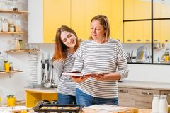 Family leisure kitchen mother daughter cooking stock images