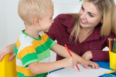 A little boy draws with the mother.Family leisure. royalty free stock images