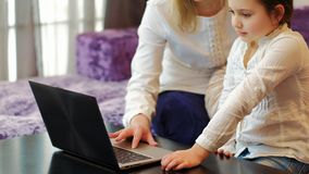 Family leisure mom daughter use laptop together. Family leisure. mom and daughter using laptop together. computer technology concept Royalty Free Stock Photos