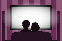 Family leisure, people behind viewing of the TV at night. On the image  is presented family leisure, people behind viewing of the TV at night Royalty Free Stock Photos