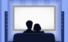 Family leisure, people behind viewing of the TV at night. Royalty Free Stock Photos