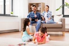 Happy family spending free time at home stock photo