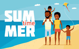 Family leisure. Summer time. Happy african family beach holiday. Family having fun at the beach Royalty Free Stock Photography