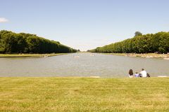 Family leisure time in Versailles garden Royalty Free Stock Photography