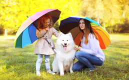 Family, leisure, weather and people concept - mother with child Stock Photo