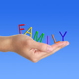Family letter in hand. On blue background stock photography